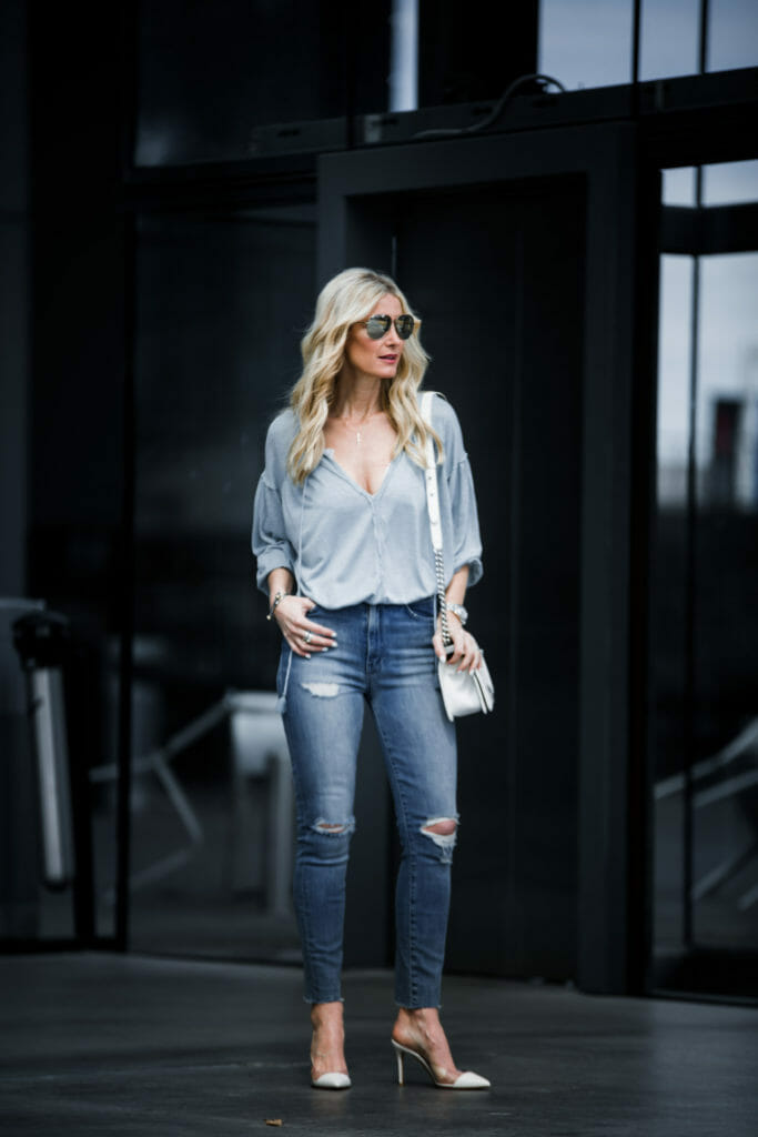 Dallas Fashion blogger wearing free people top and ripped jeans