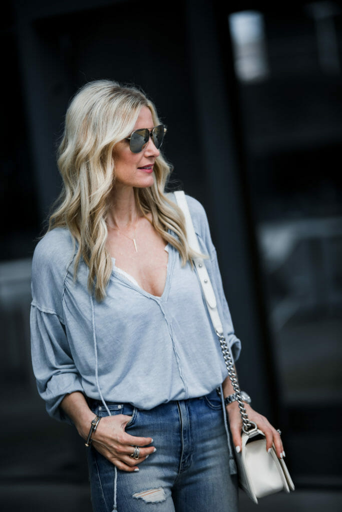 Heather Anderson wearing Chanel Boy Bag and Spring top