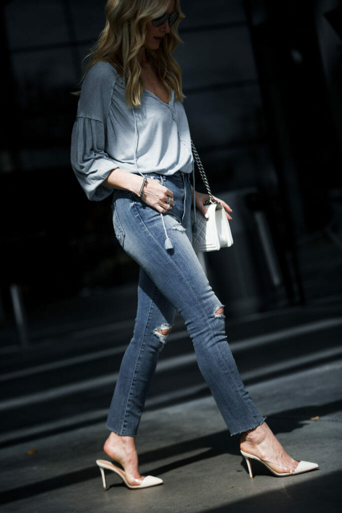 Ripped jeans and white pumps