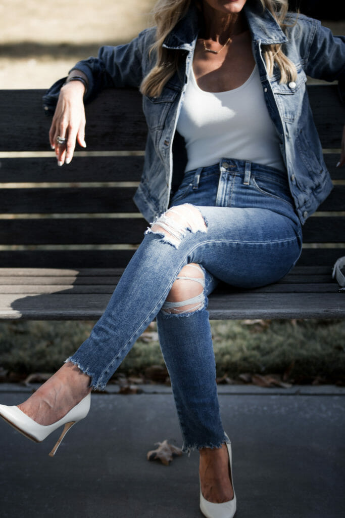Heather Anderson wearing white pumps and ripped jeans