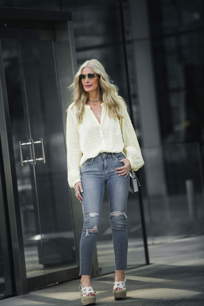 Dallas Blonde wearing ripped jeans and summer wedges