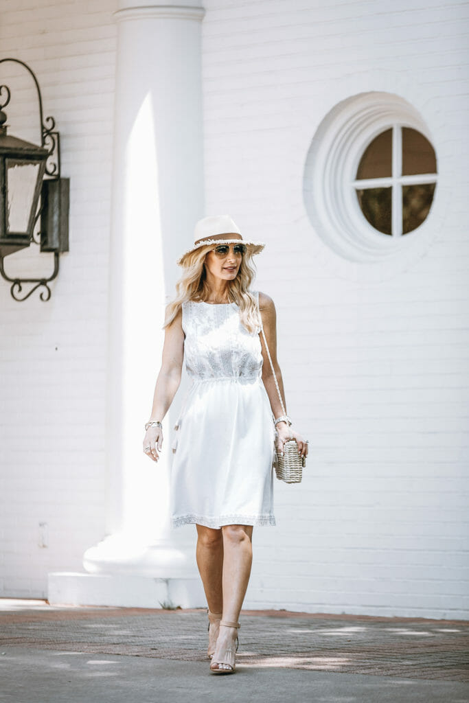 Dallas blogger wearing casual summer dress and straw hat