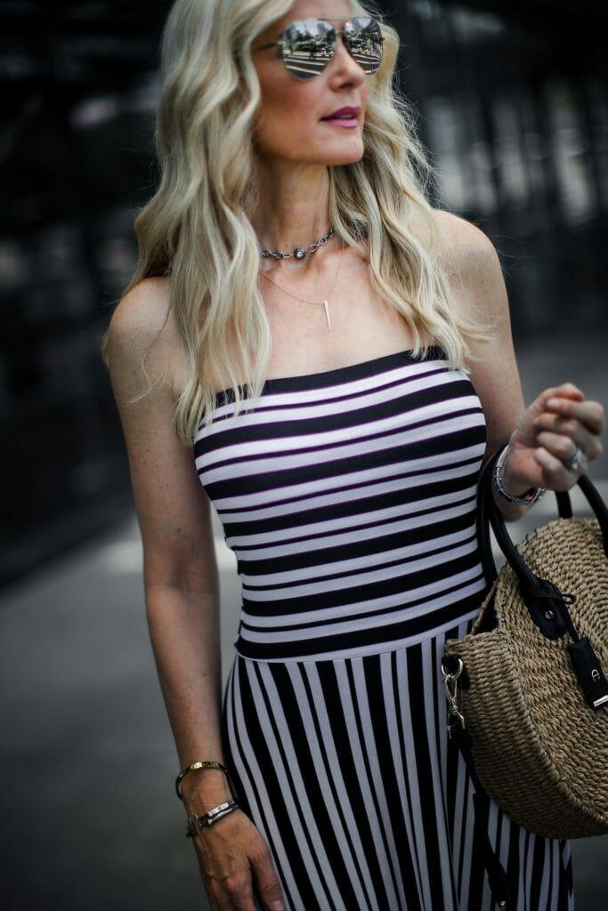 Dallas blonde girl wearing strapless maxi dress