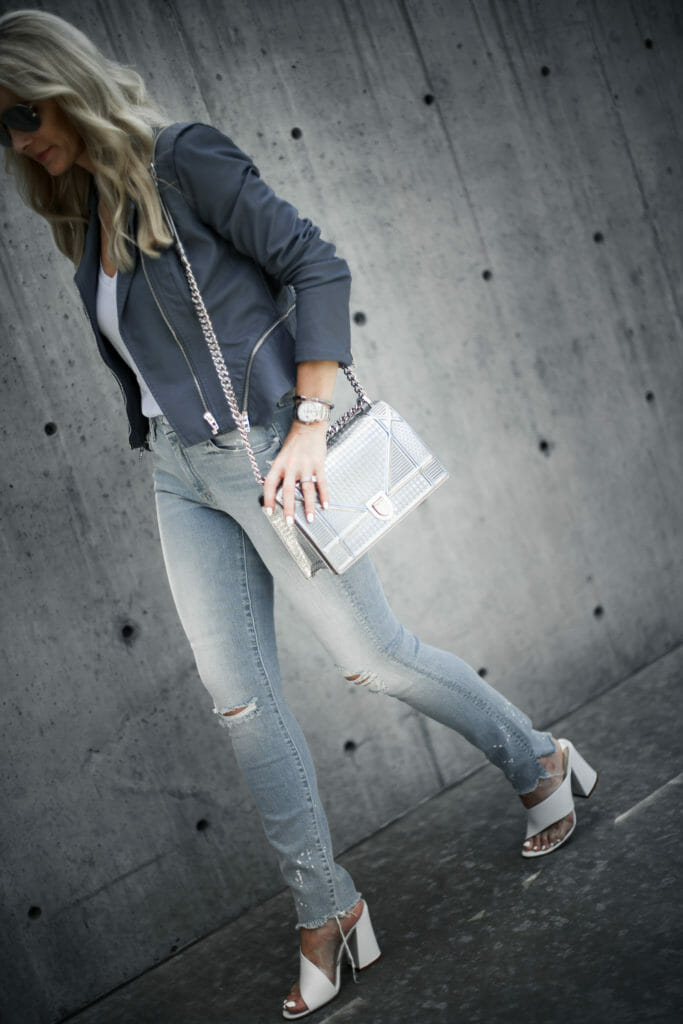 Dior handbag and ripped jeans