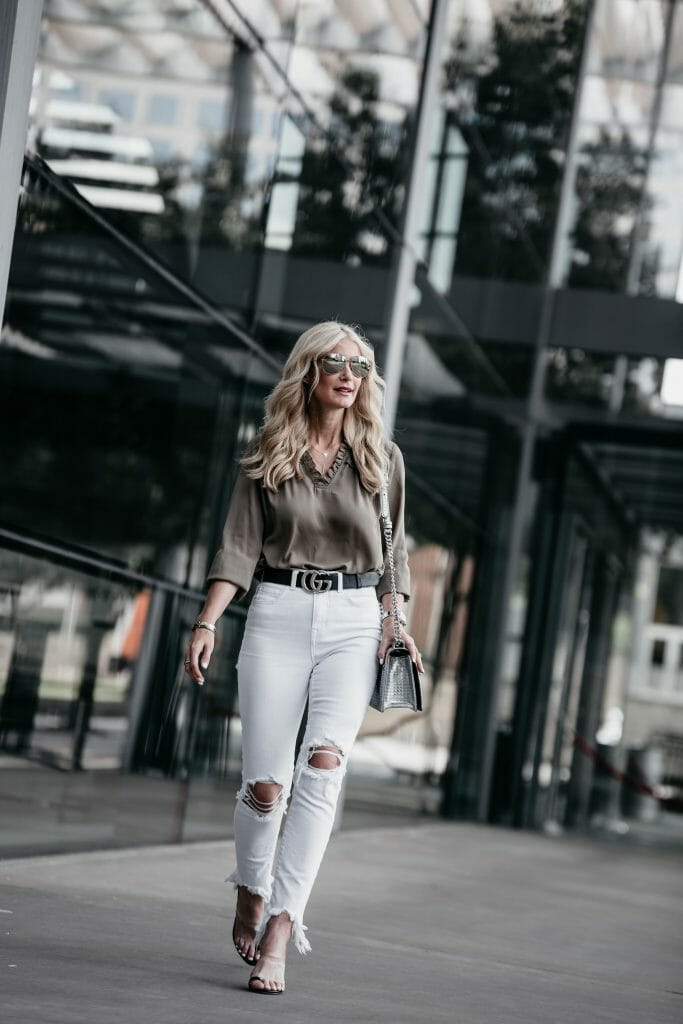 Dallas style blogger wearing ruffle top and white jeans