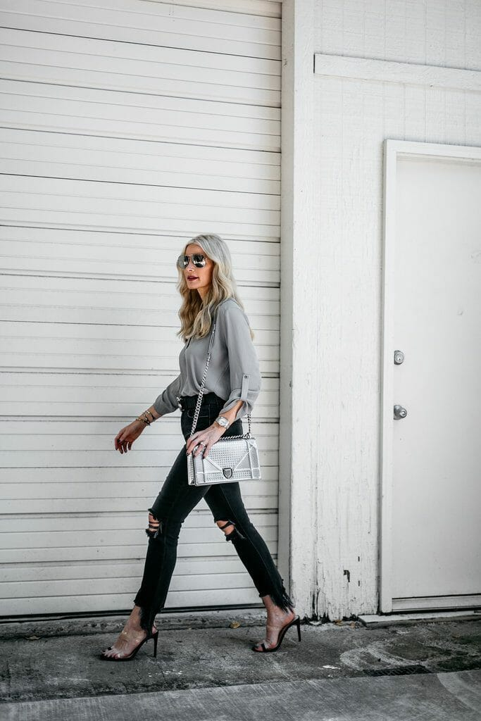 Black ripped jeans and gray tunic