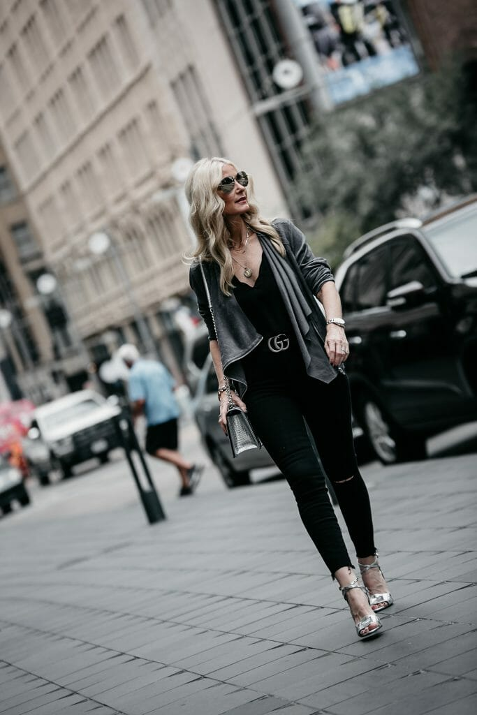 Dallas style blogger wearing Gucci belt and black jeans