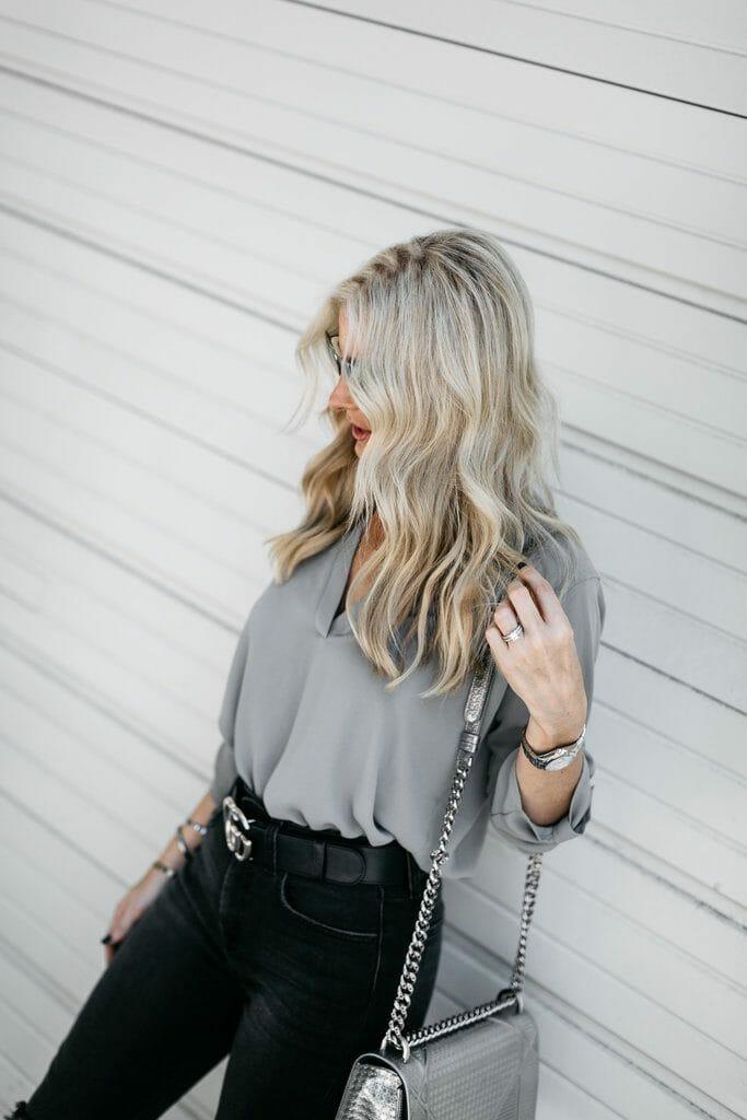 Dallas blonde women wearing Gucci belt and jeans
