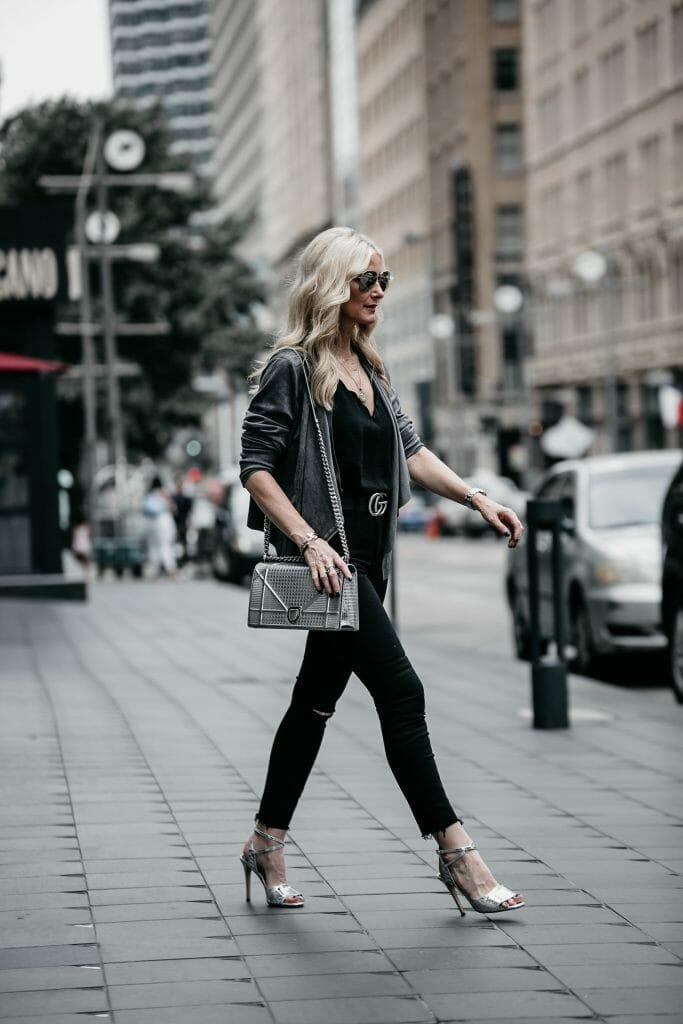 Dallas fashion blogger wearing Dior handbag and black jeans