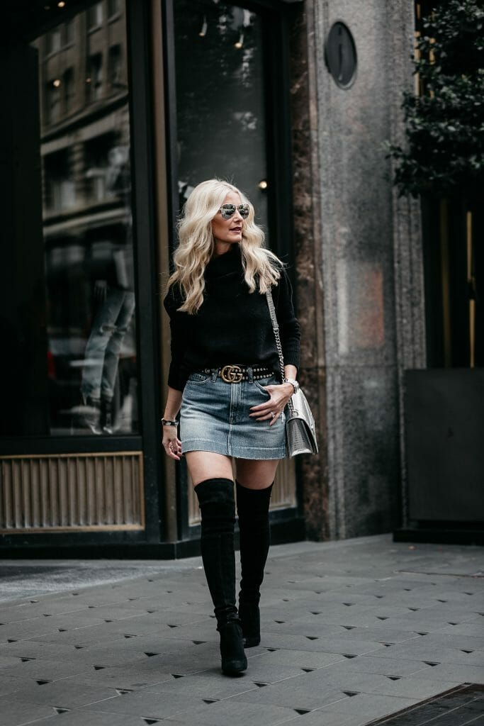 Frame denim skirt and over the knee boots on Dallas style blogger