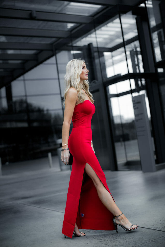 Dallas style blogger wearing a red strapless dress