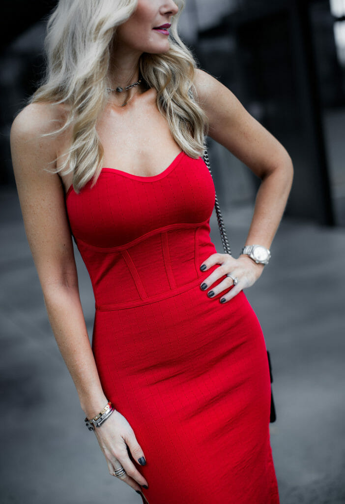 Dallas fashion blogger wearing a red strapless dress