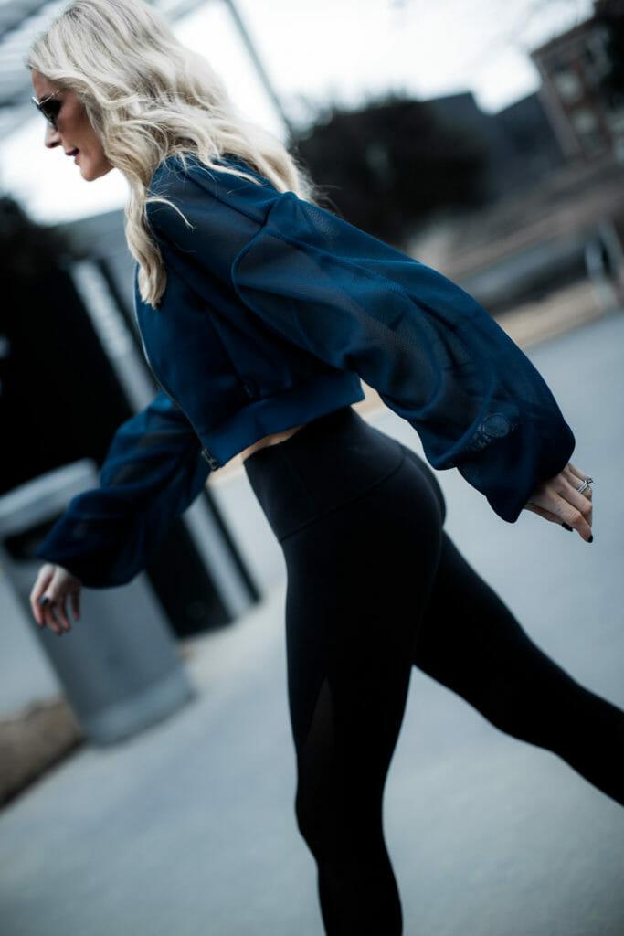 Dallas fitness blogger wearing Alo yoga cropped bomber jacket