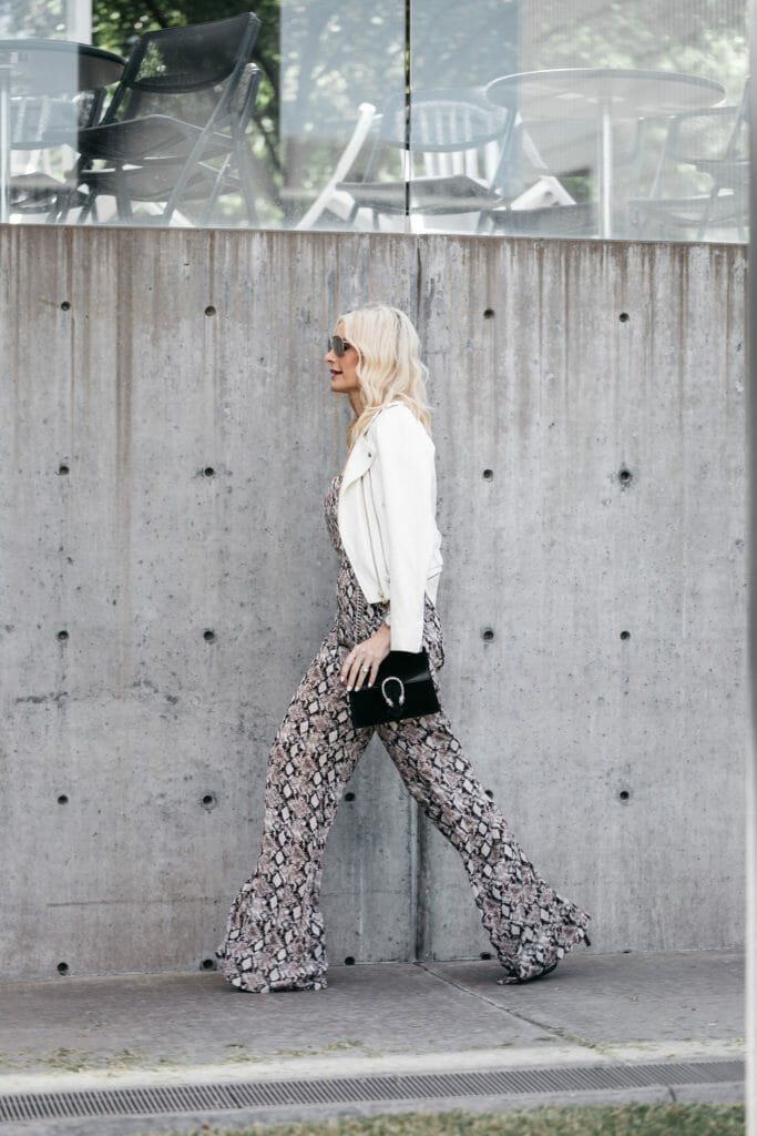 Dallas fashion blogger carrying Gucci bag and wearing white leather jacket