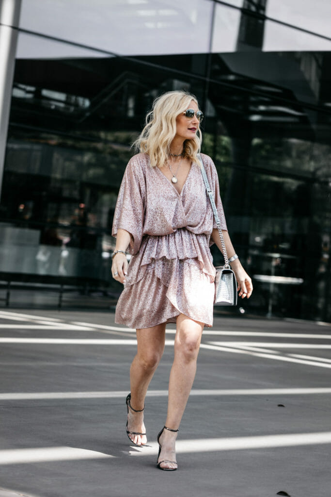 Dallas blogger wearing a pink metallic dress and silver heels