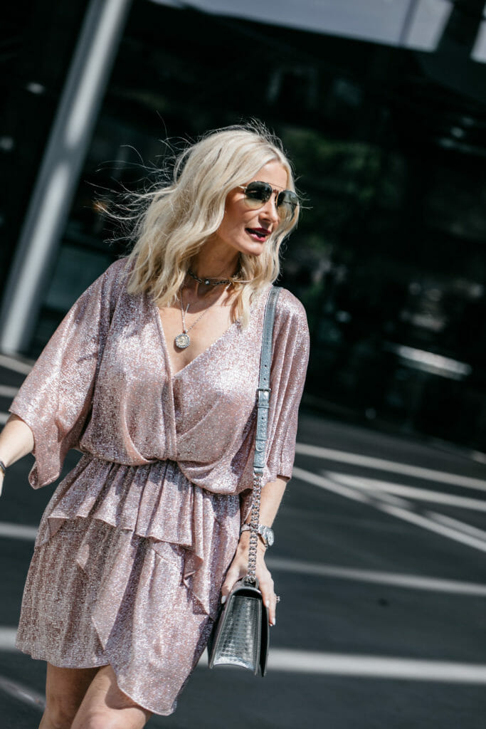 Dallas blogger wearing a pink mini dress and coin necklace