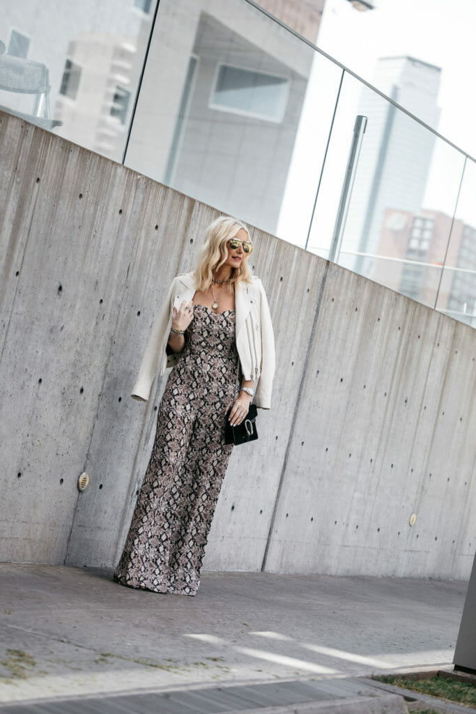 Dallas blogger wearing snake print jumpsuit