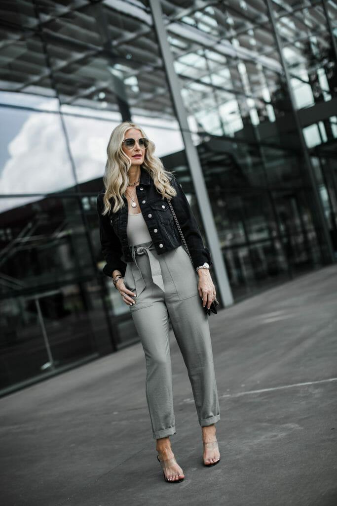 Dallas blogger wearing paper bag waist pants and denim jacket