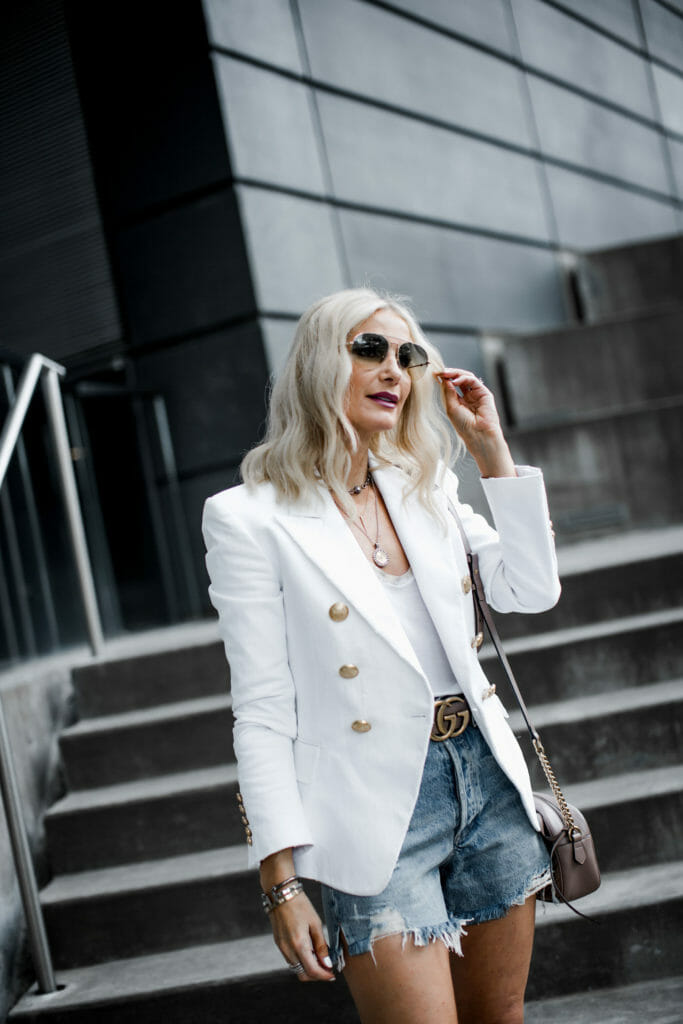Dallas blogger wearing Balmain blazer and denim cut-offs