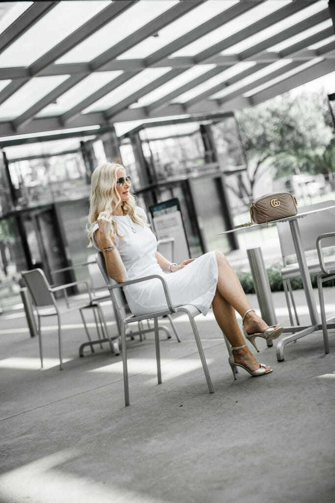Dallas blogger wearing a Veronica Beard white dress and gold heels