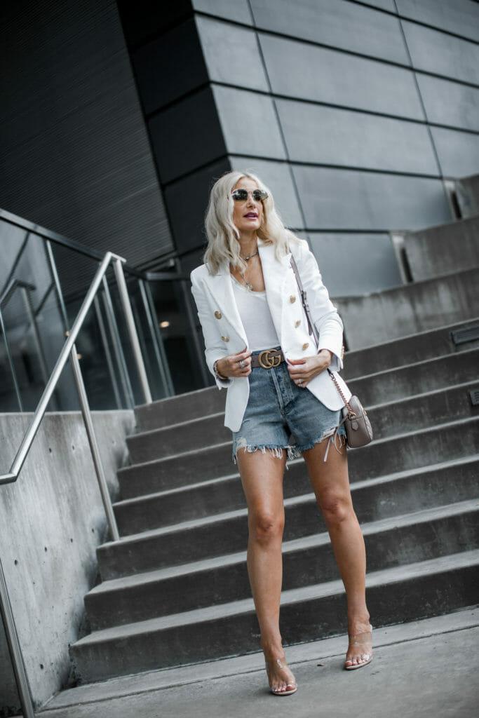 Dallas style blogger wearing Gucci belt, Balmain blazer, and cut-offs