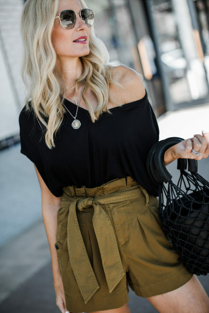 Dallas fashion blogger wearing a black tee and Topshop shorts