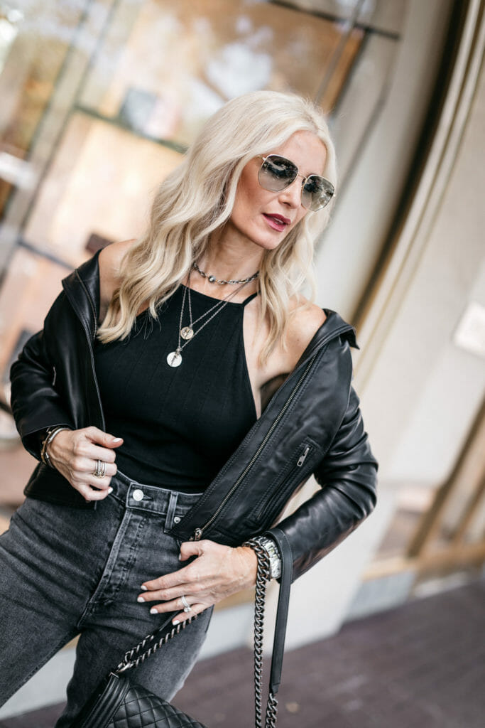 Dallas style blogger wearing a black bodysuit and leather jacket