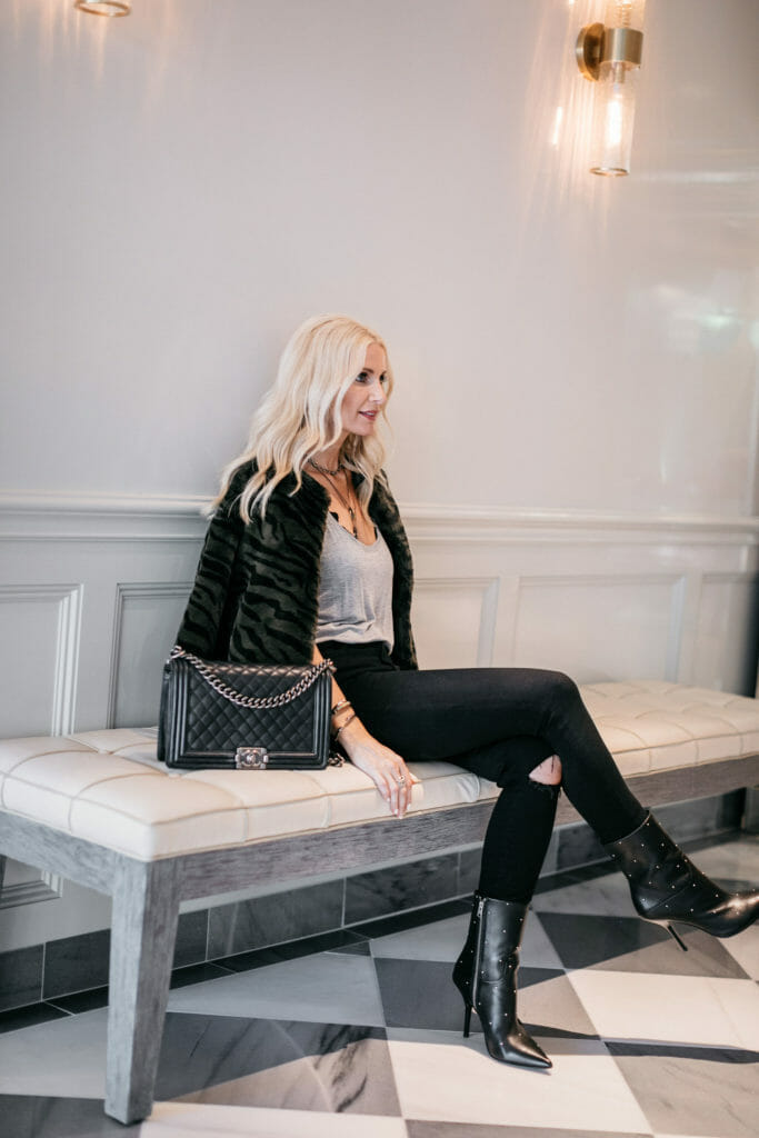 Dallas blogger wearing a faux fur jacket and black booties