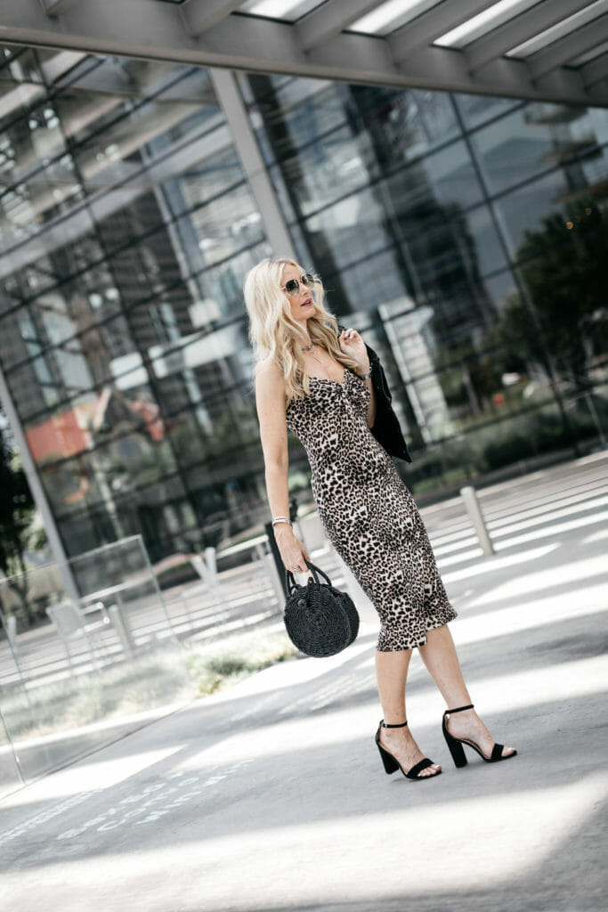 Dallas blogger wearing a leopard midi dress