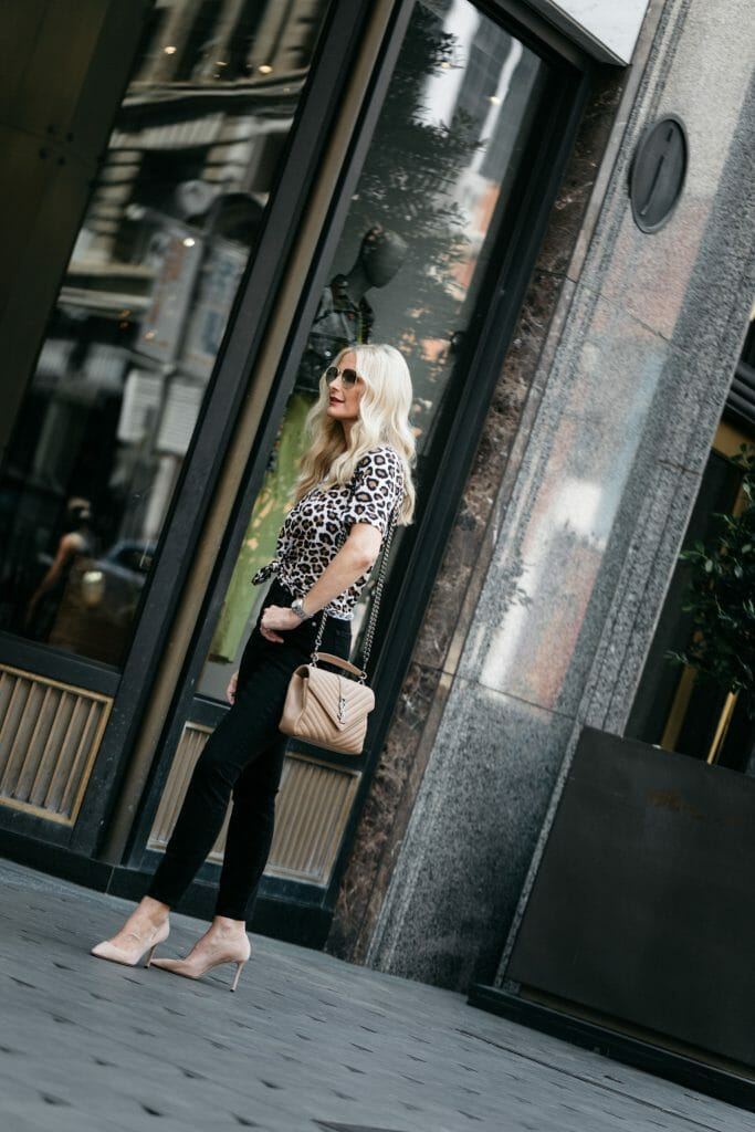 Dallas influencer wearing Jimmy Choo pumps and a leopard tee