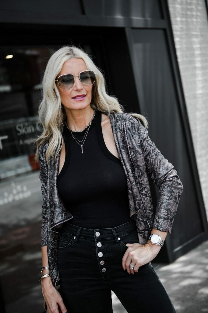 Dallas influencer wearing a snake print jacket and black skinny jeans