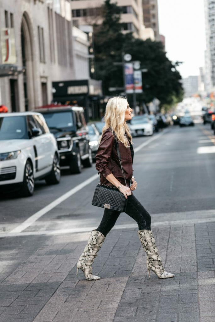 Dallas blogger wearing Schutz Snake Print boots