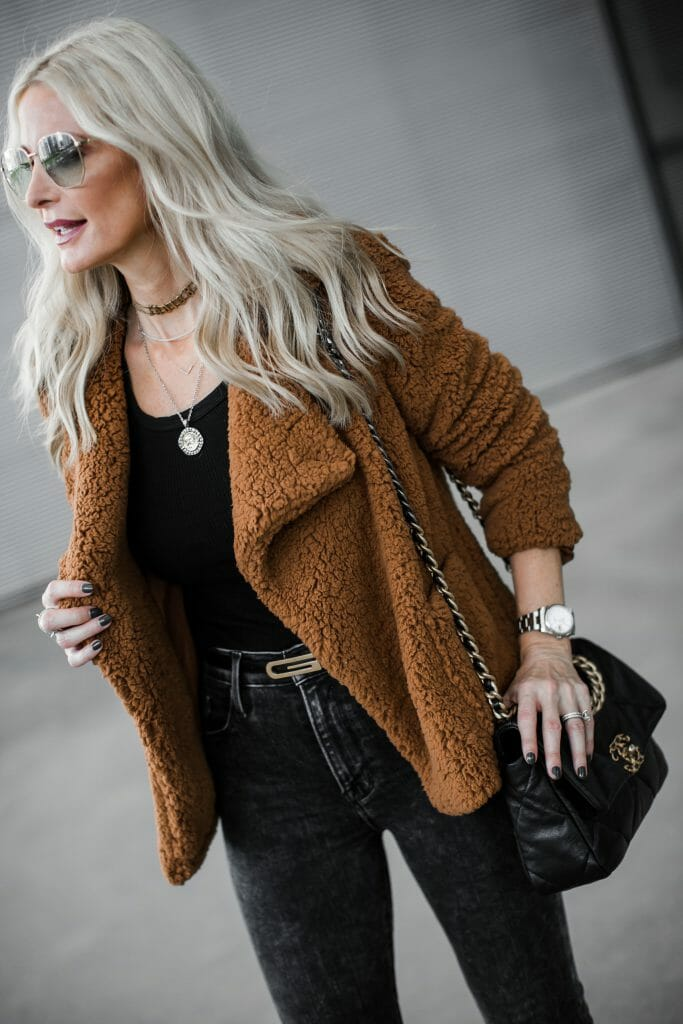 Dallas influencer wearing a Gucci belt and a camel teddy coat