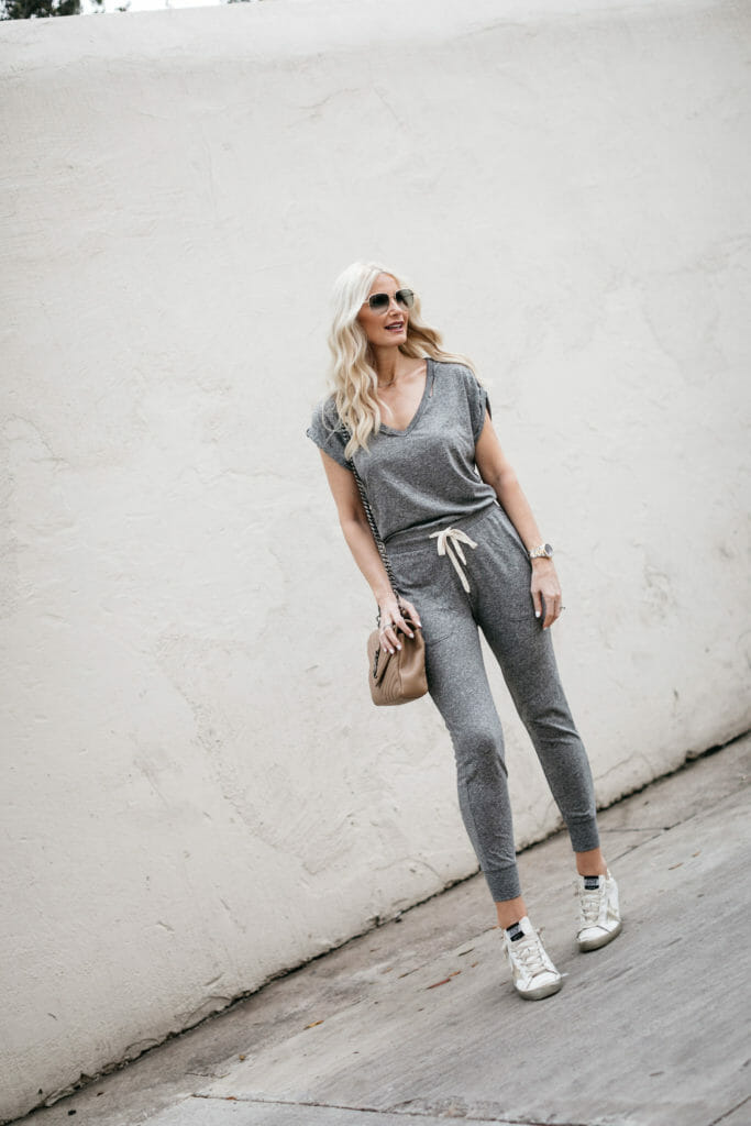 Fashion blogger wearing a gray jumpsuit