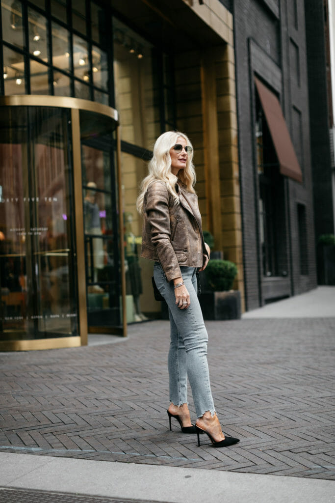 Style blogger wearing jeans and heels
