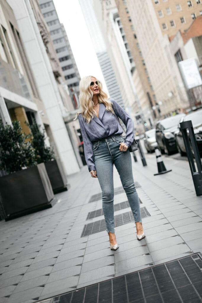Dallas fashion blogger wearing a blue bodysuit and denim