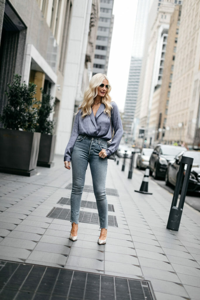 Dallas blogger wearing a blue bodysuit and blue jeans