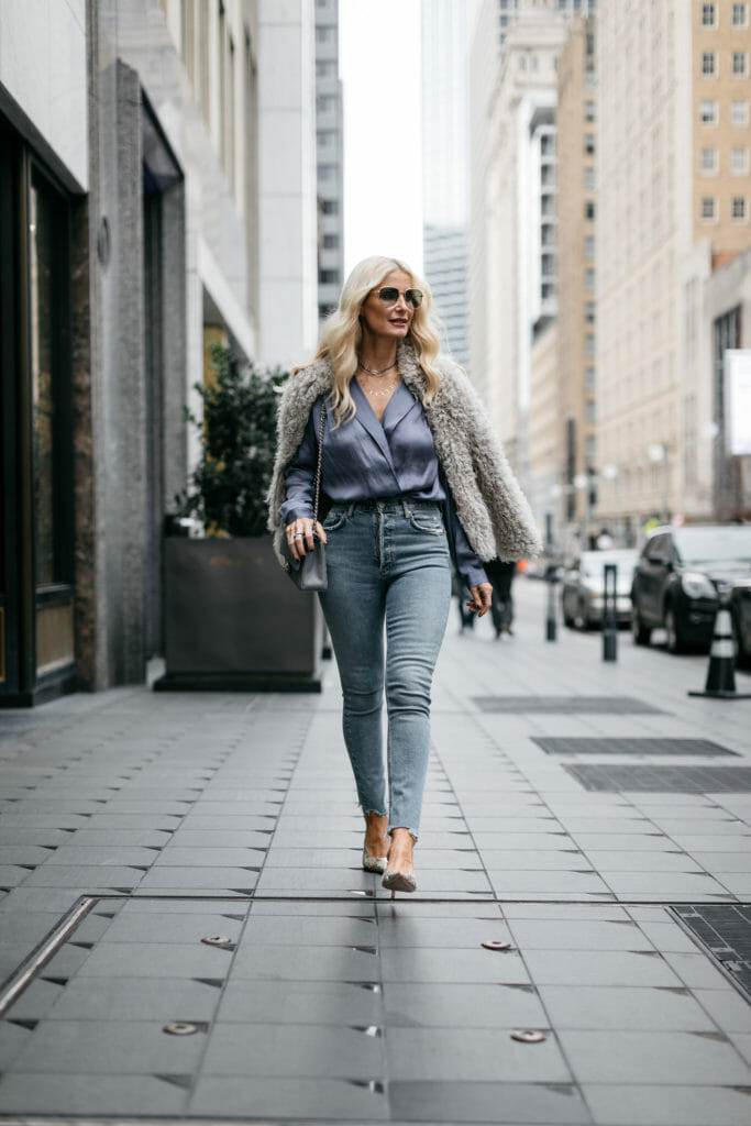 Dallas style blogger wearing a blue bodysuit and blue jeans