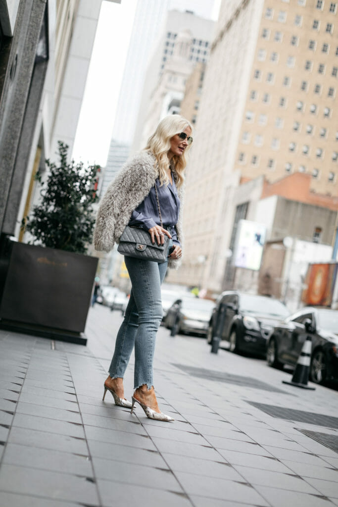 Style blogger wearing snake print heels and blue jeans