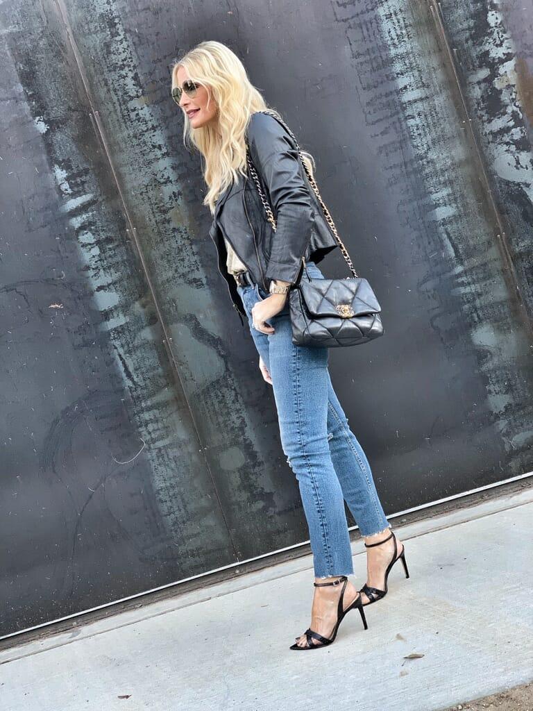 Blogger wearing denim and black heels