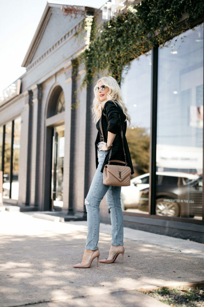 Influencer wearing a black blazer with denim and heels