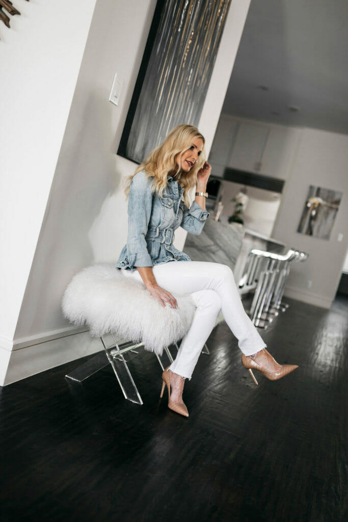 Style blogger wearing a denim jacket and white jeans