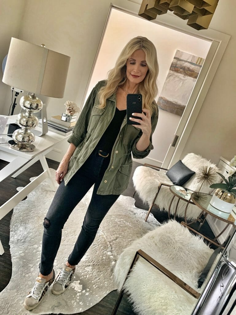 Style influencer wearing an army jacket and black denim