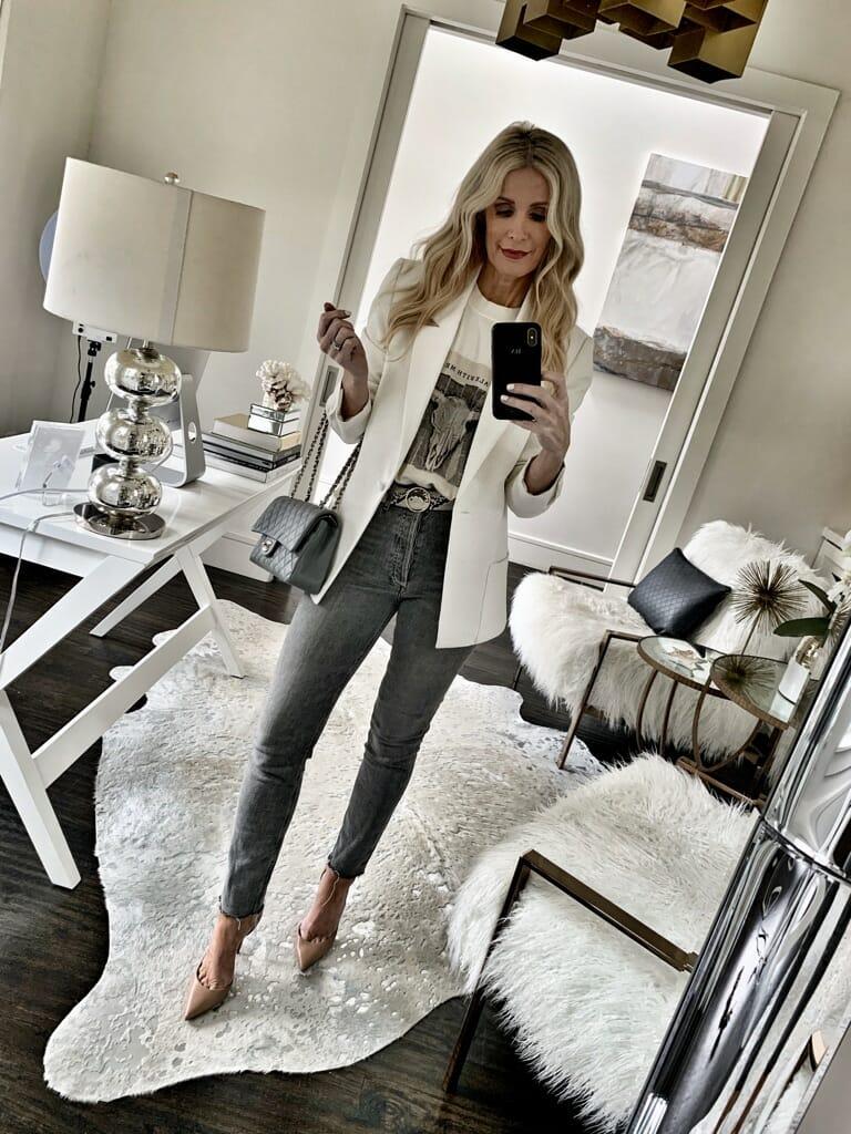 Dallas influencer wearing a white blazer and heels