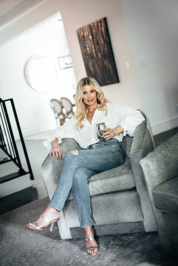 Dallas fashion blogger wearing a white blouse and ripped denim