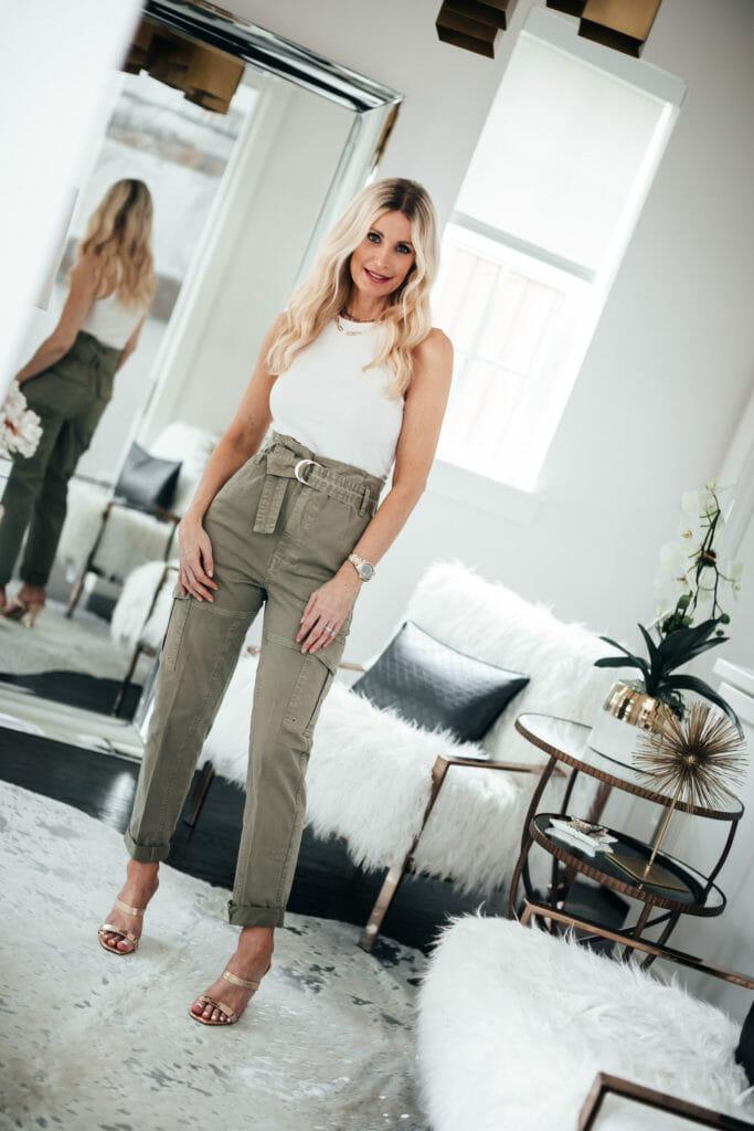 Dallas fashion blogger wearing a summer tank and green pants