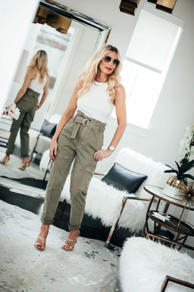 Fashion blogger wearing paper bag waist pants and a white tank
