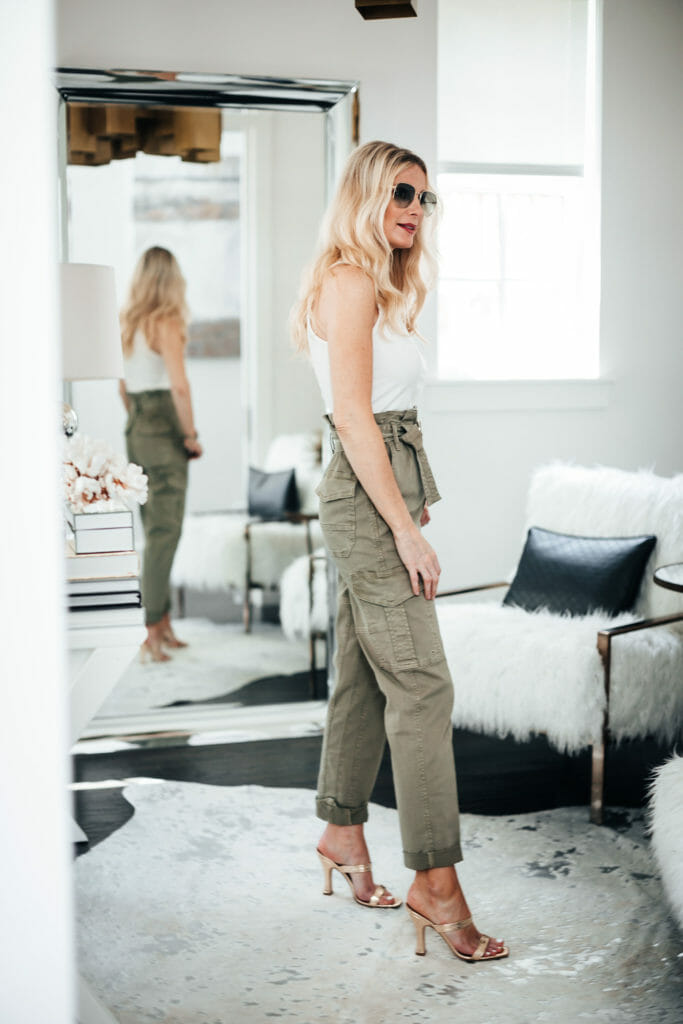 Dallas blogger wearing army green pants and gold heels