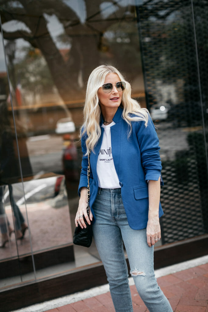 Dallas influencer wearing Gucci sunglasses and a blue blazer