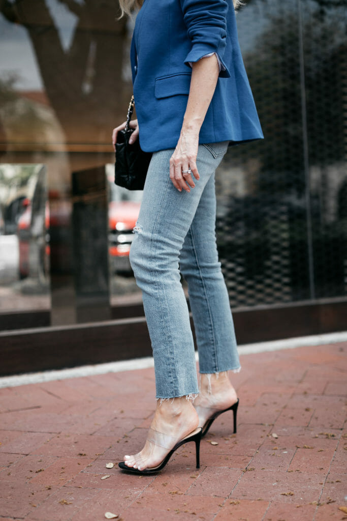 Dallas style blogger wearing light wash jeans and heels